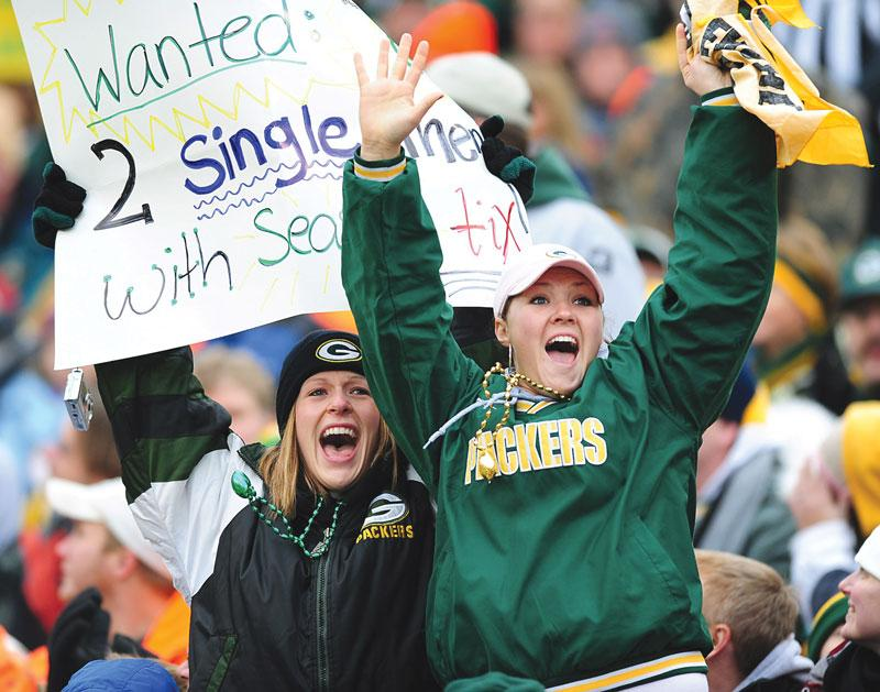 Two Green Bay Packers fans show their support for their team during a game. Photo Caption: Jeff Siner / MCT
