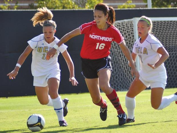 Freshman Melissa Fernandez tries to get by the Bruin defense in Fridays 2-0 loss to No. 3 UCLA. Photo Caption: