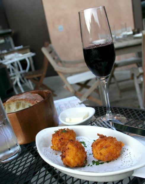 Saffron arancini stuffed with smoked mozzarella. Photo Credit / Raspina Jannefar
