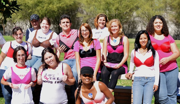 The CSUN chapter of Colleges Against Cancer support this month of cancer awareness by wearing bras over their shirts, Moday, Oct. 20. Photo Credit: Camille Hislop / Staff Photographer