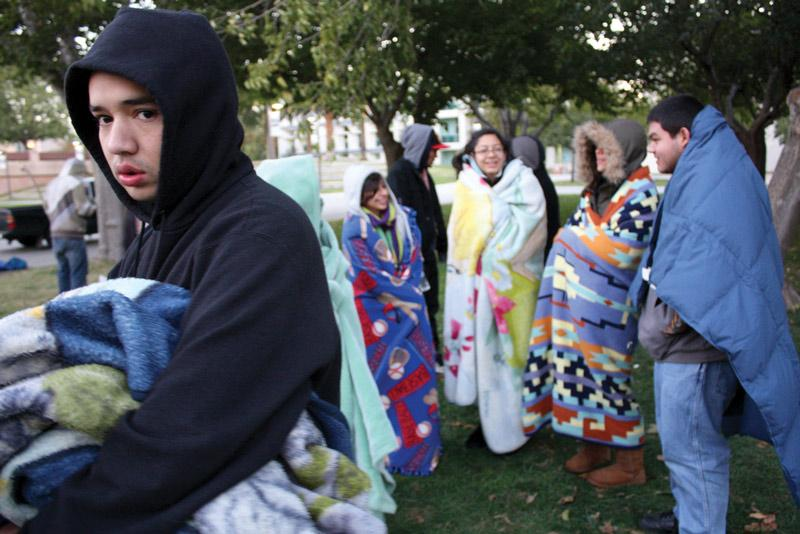Students bundle up on the cold 6 a.m. hour of Nov. 15, after surviving the night on the Oviatt Lawn. Photo Credit: Bodhi Severns / Contributing Photographer