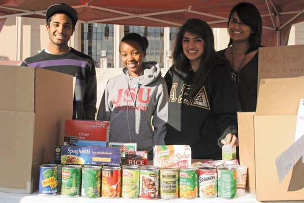 The location drop-off center for CSUN's United We Serve Volunteer Program  food and clothing drive is located in front of the Oviatt Library. Photo Credit: Caitlin McCarrick / Staff Photographe