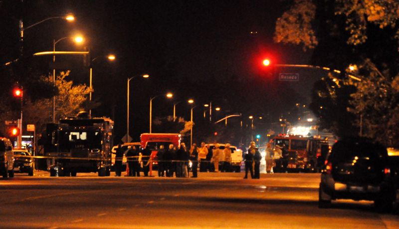 Los Angeles police and fire officials are stationed at the intersection of Reseda Boulevard and Lassen Street in Northridge, where a car filled with explosives had been brought, Thursday, Nov. 19, 2009. The explosives were later detonated on site.