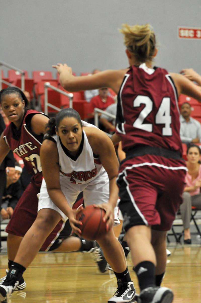 Jasmine Erving faces Aggie Madison Spence in the midst of the Matadors' 79-72 loss at the Matadome Friday afternoon. Erving scored 25 points. Photo Credit: Sami Eshaghi / Assistant Photo Editor