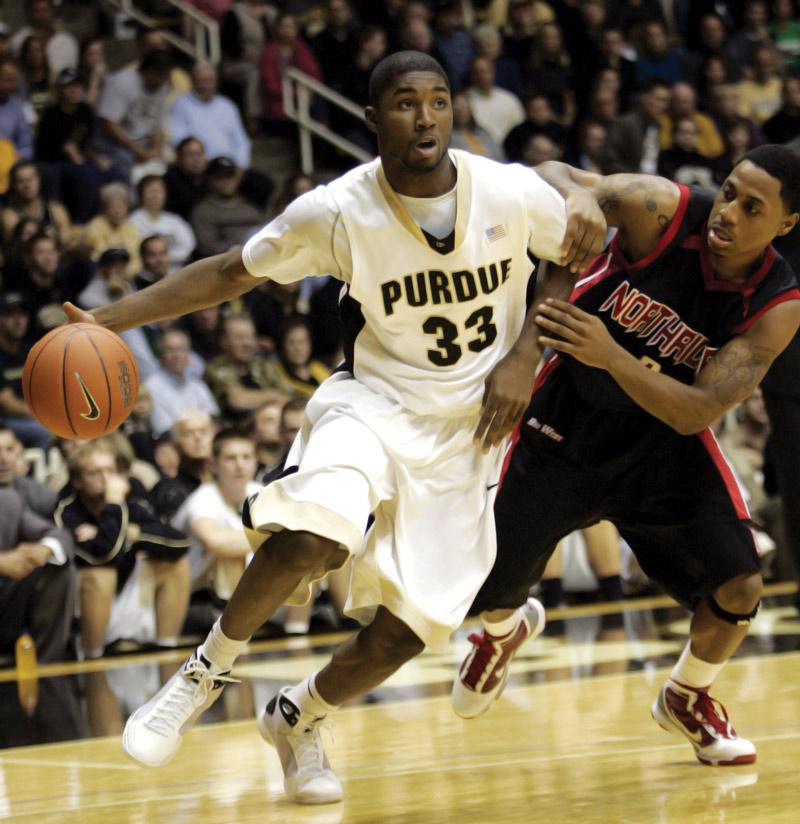 Purdue guard E'Twaun Moore (33) drives around Cal State Northridge guard Mark Hill, right, during the second half of an NCAA college basketball game in West Lafayette, Ind. Friday. Photo Credit: Tom Strattman / AP photo