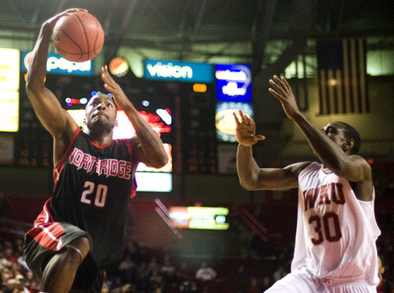 CSUN's Kenny Daniels goes up for a layup against Western Kentucky's A.J. Slaughter as Anthony Sally looks on in Bowling Green, Ky., Monday. The Matadors fell to the Hilltoppers, 68-67, at E.A. Diddle Arena. Photo Credit:Albert Cesare / Courtesy of the College Heights Herald