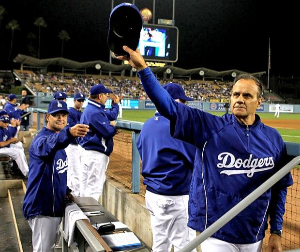 Los Angeles Dodger manager Joe Torre (right) gives a curtain call to the fans at Dodger Stadium during a game. Photo Credit: Courtesy of MCT