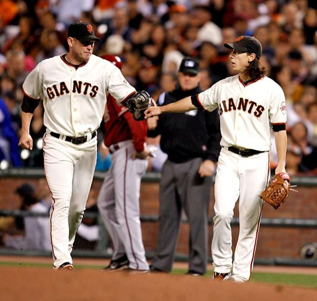 San Francisco Giants' pitcher and two-time Cy Young winner Tim Lincecum gives a fist-pump to Aubrey Huff after they got an out at first base. Lincecum and the  other Giants pitchers need to step up their game in the playoffs.  The bull-pen that has been exceptional will need rest if the Giants want to go farther than the first series. Photo Credit: Courtesy of MCT