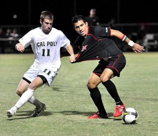 Matador Carlos Benavides (21) keeps control of the ball as he avoids a Mustang defender during their last match of the season Saturday. CSUN finished with a record of 3-14-2 and 2-7-1 in the Big West Tournament. Photo Credit: Patrick Dilanchian/ Contributing Photographer