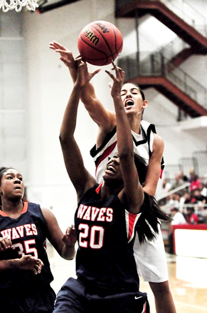 Matador Violet Alama (23) goes up against Wave center Jade McNorton (20) during Wednesday's home opener at the Matadome.  photo credit: Patrick Dilanchian / Contributing Photographer
