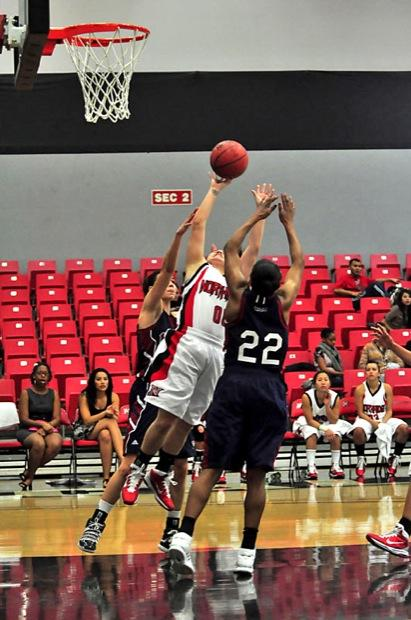 Paige McIntyre (00) goes for a shot between two LMU defenders during the second half of the Matadors 69-52 defeat at the Matadome Wednesday night. Photo Credit: Patrick Dilanchian/ Contributing Photographer