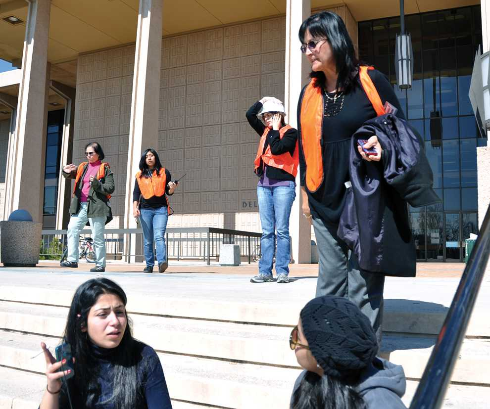 Library Administrator Mickey Martinez asks students to move down the stairs after a fire alarm activated in the Oviatt Library Tuesday.  Students were allowed back into the library after it was determined to be a false alarm. Photo Credit: Herber Lovato / Staff Photographer