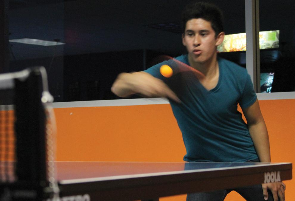 Freshman Kyle Alcazar, 19, business marketing, serves the ball during the final round of Tuesday's table tennis tournament in the USU's game room. Alcazar came out of the tournament undefeated. Photo Credit: Tessie Navarro / Staff Photographer
