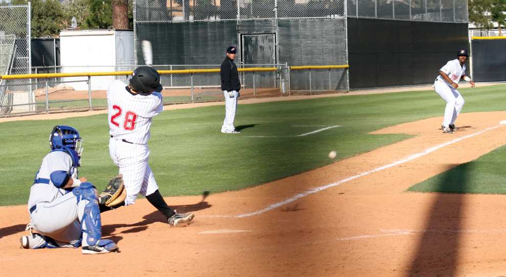 CSUN infielder Justin De Marco (28) singles down the left field line and scores Chris Allen from third base in the eighth inning of Friday's 15-5 loss to Cal State Bakersfield at Matador Field. Photo Credit: Ignacio Marquez / Assistant Sports Editor