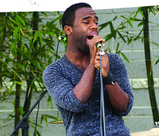 Vincent Coleman, 24, lead singer of Vas Defrans belts out a song during the noontime concert Thursday, April 21, 2011 at Plaza del Sol. Photo Credit: Katie Donahue / Contributing Photographer