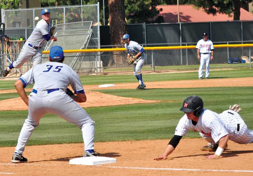 CLOSE CALL: CSUN's Kyle Attl slides back to first base after UCSB's pitcher throws in a pick off attempt in Friday's 4-0 victory over the Gauchos at Matador Field. CSUN will face UC Riverside in search of its second Big West series win. Photo Credit: Herber Lovato / Assistant Photo Editor