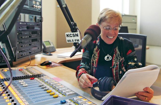Karen Kearns, general manager of KCSN, reads a script and demonstrates what she would normally do to record