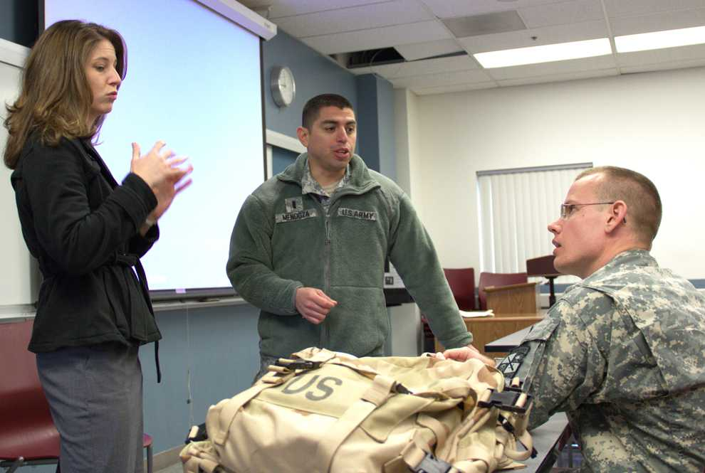 Keith Nolan meets with Capt. Sid Mendoza (center) from CSUN ROTC. Nolan has been able to communicate through interpreter Rita Alexander (far left) during his participation in ROTC. Photo Credit: Courtesy of Keith Nolan