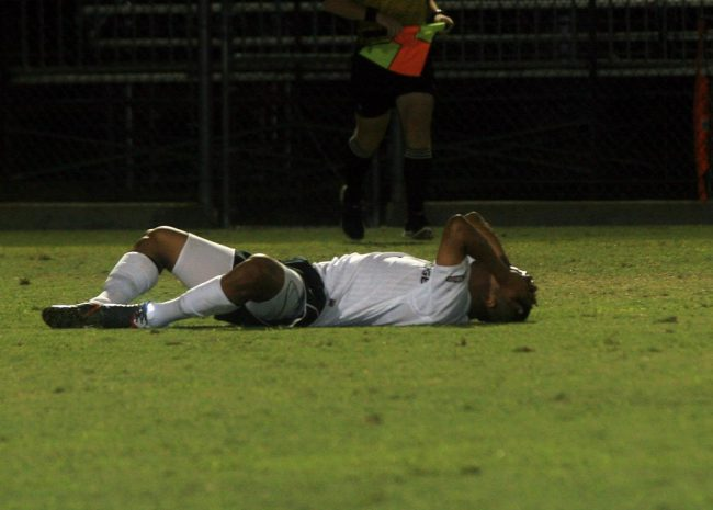 Disappointment: One of the Matadors falls to the ground and covers his face following CSUN's 2-1 overtime loss to UNLV at the Cal State Northridge Labor Day Classic on Thursday night. Photo Credit: Daniel Hoyos / Contributing Photographer
