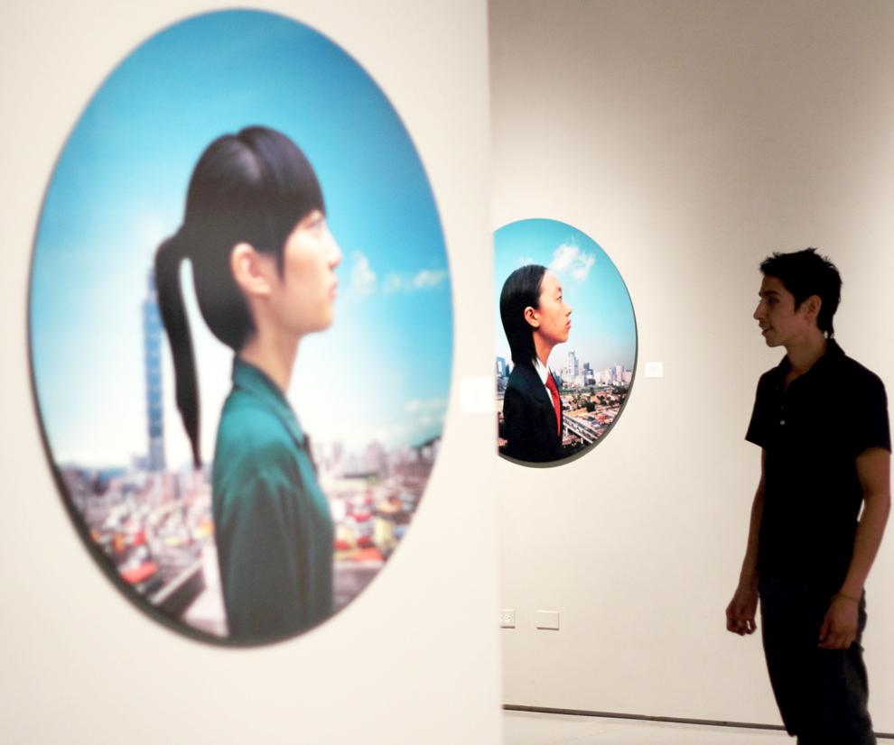 Student Danny Escalante, who is working on his masters degree in art, admires the installation currently exhibited at the CSUN Art Gallery. Simon Gambaryan / Daily Sundial
