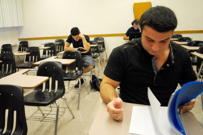 Ari Emuriamn, 23, economics major, reviews his book as he waits for his 9:30 a.m. Latin America georgraphy class to start.