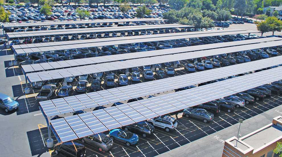 More than 2,800 165-watt solar panels cover this faculty lot on the southwest side of campus to help contribute to more than $140,000 annually in energy costs and give shade to parked cars. Photo Credit: Andres Aguila / Daily Sundial