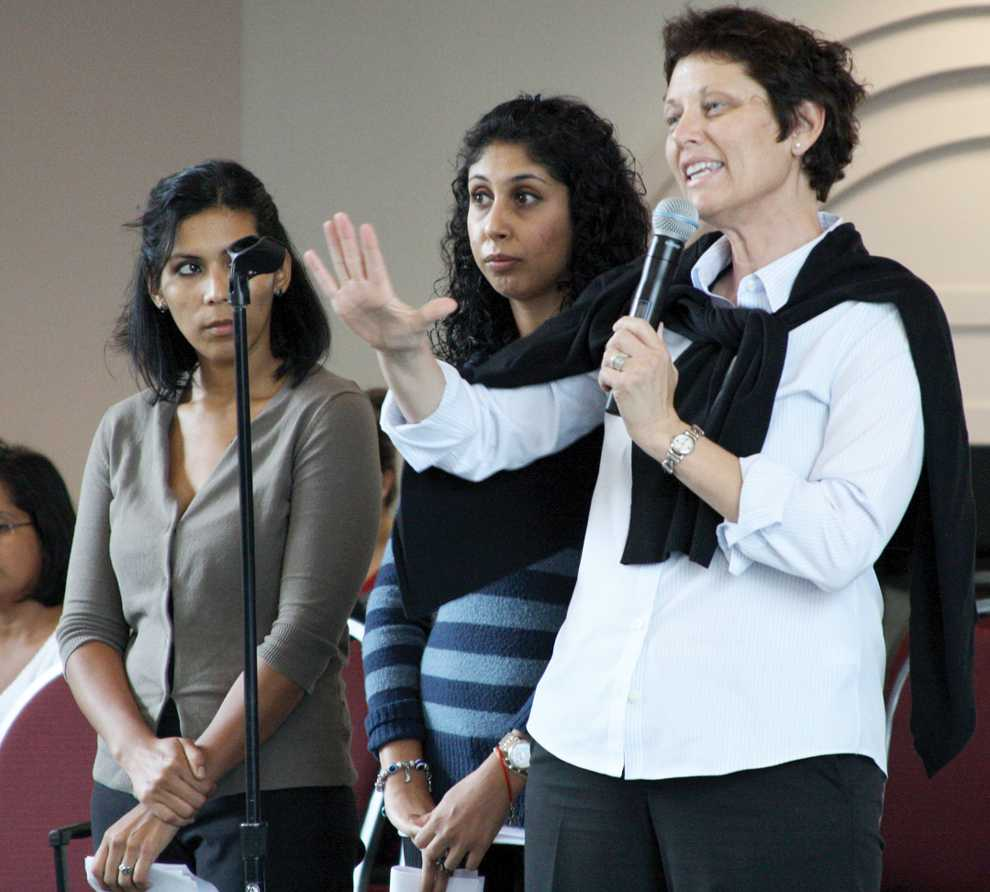 Charlem Mikail (left), Marlem DePhilipis (center) and Kathleen Young of COUGH address AS asking them to sign a proposal which would establish designated smoking areas on campus. Photo Credit: Mariela Molina / Visual Editor