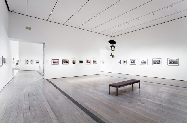 Photographs depicting the political performances of Asco line the walls of an exhibit at LACMA. Courtesy of LACMA
