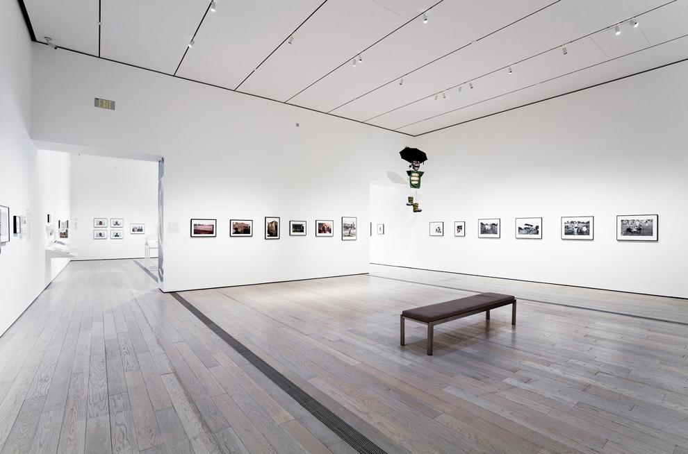 Photographs+depicting+the+political+performances+of+Asco+line+the+walls+of+an+exhibit+at+LACMA.+Courtesy+of+LACMA