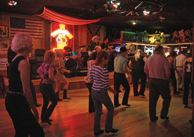 Cowboy Palace Saloon patrons enjoy an evening of live music and line dancing. Photo Credit: Katie Grayot / Daily Sundial