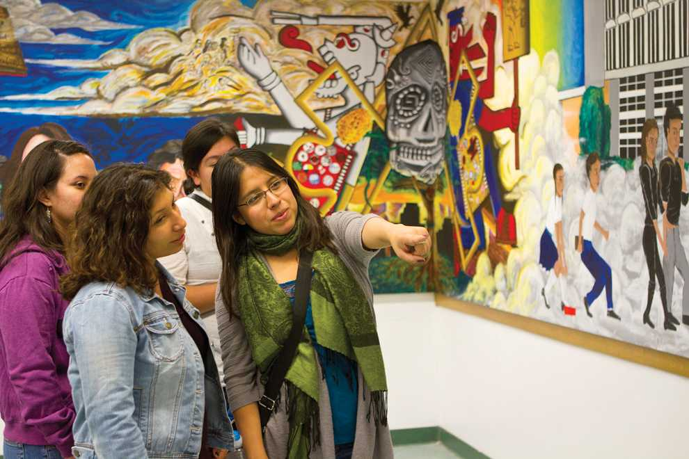 Students%2C+faculty+and+family+members+admire+the+new+mural+in+Jerome+Richfield+130.+Kat+Russell+%2F+Daily+Sundial