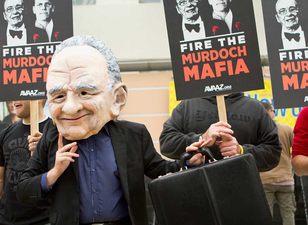 A protestor dons a Rupert Murdoch costume head at the 20th Century Fox protest on Friday, October 21. Protestors are calling for the dismissal of the Murdochs from News Corp. Kat Russell / Daily Sundial