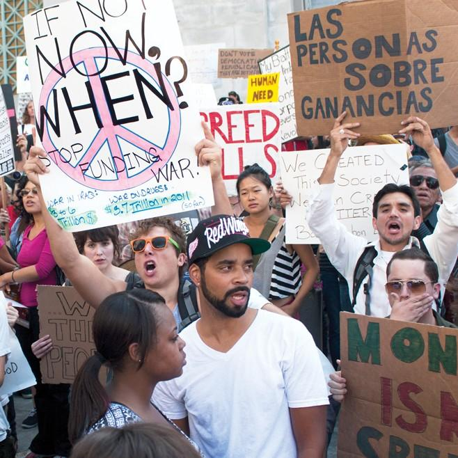 Hundreds+of+protesters+stand+outside+Los+Angeles+City+Hall+to+make+their+voices+heard+on+Saturday.+Photo+Credit%3A+Jessica+Albano+%2F+Contributor