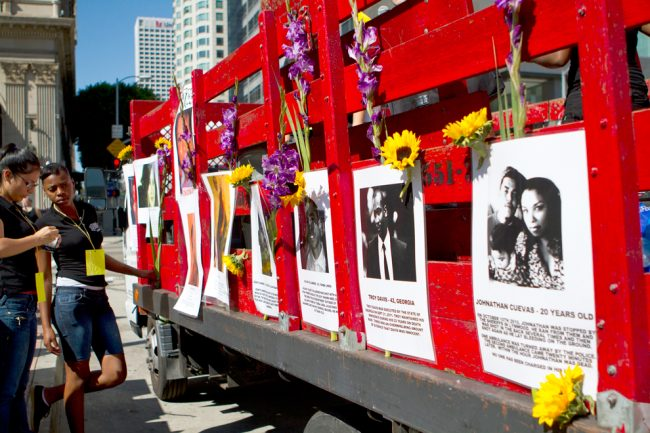 A red truck, covered on the sides with posters of alleged victims of police brutality and murder, took the lead in the