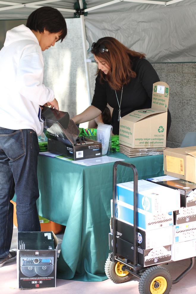 Talin Keshishian, program manager of Planet Green, receives empty ink cartridges for proper recycling. Simon Gambaryan / Daily Sundial