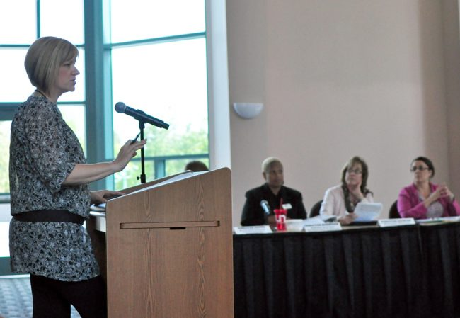 Associate Director of Marketing and Programs, Shannon Krajewski reviews details of the anticipated Student Recreation Center during the Board of Directors Meeting yesterday. Photo Credit: Katie Grayot / Daily Sundial