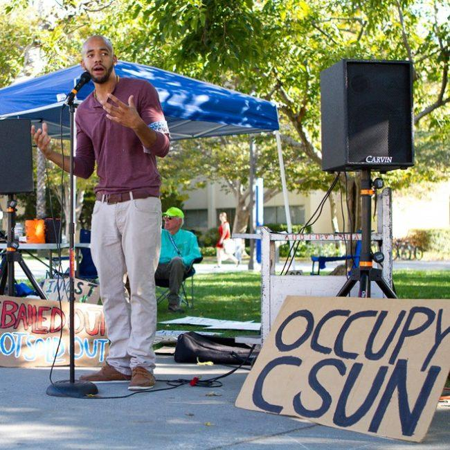 Justin Marks, co-founder of the Activist Student Coalition, speaks to the Occupy CSUN participants before they head out on their march towards the Wells Fargo on campus on Monday. Kat Russell / Daily Sundial