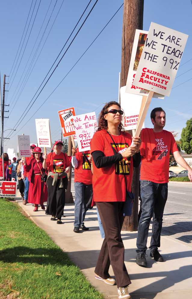 Faculty+members+march+along+Victoria+Street+in+front+of+Cal+State+Dominquez+Hills+in+protest+to+unpaid+raises+and+quality+of+education+for+students+on+Thursday+Nov.+17.+Anthony+Carpio+%2F+Daily+Sundial