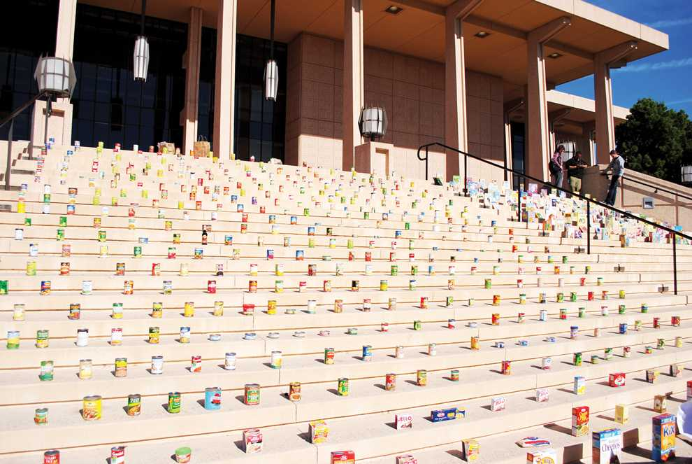 Canned foods and books sit on the steps in front of the Oviatt Library. The Unified We Serve volunteer program collected around 16,000 items in this years 3rd annual CSUN Campus clothing and food drive. Thursday, Nov. 17. Photo Credit: Andres Aguila / Daily Sundial