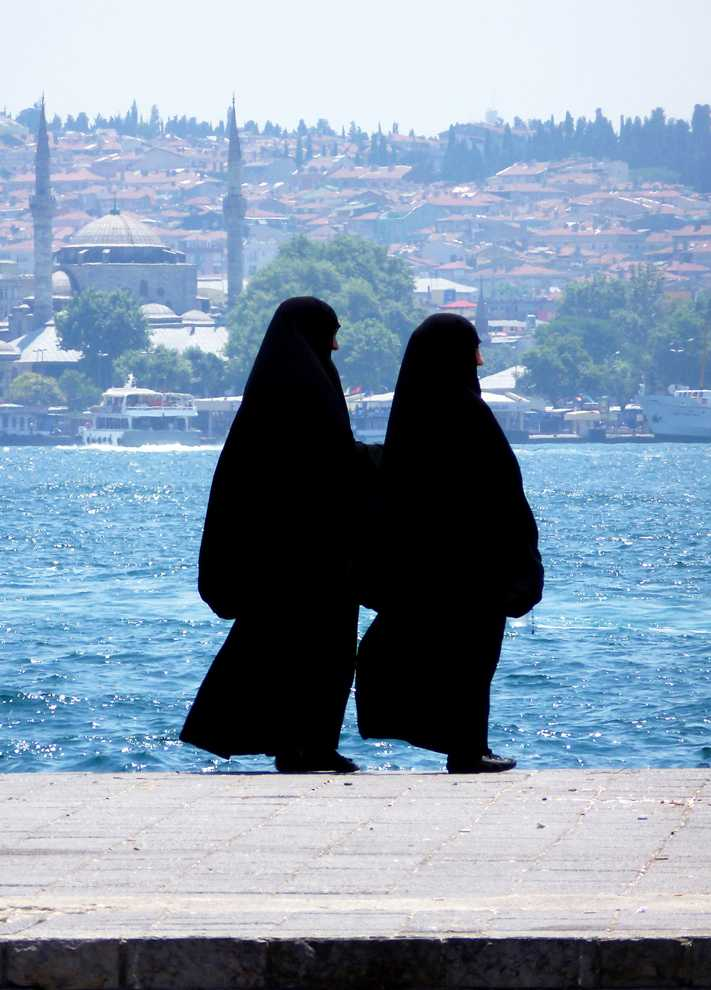 Two muslim women stand on the bank of the bosphorus in Istanbul, Turkey. Turkey is a predominantly Muslim country - approximately 99 percent. Kat Russell / Daily Sundial