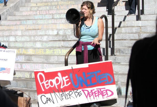 A woman standing on the steps of Los Angeles City Hall speaks to occupiers on Friday, November 11. Photo Credit: Tessie Navarro / Visual Editor