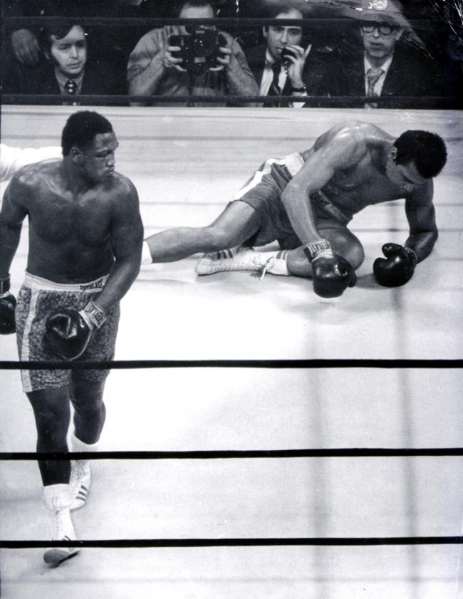 In this 1971 file photo, Joe Frazier heads for a neutral corner, as a dazed Muhammad Ali struggles to stand during their heavyweight championship in New York City. Frazier, the former heavyweight champion, has died. He was 67. (Elwood P. Smith/Philadelphia Daily News/MCT)