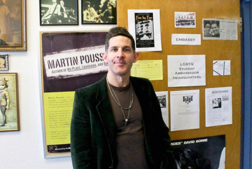 Martin+Pousson%2C+associate+English+professor%2C+has+been+an+advocate+of+the+LGBT+community+since+his+college+years.+He+now+serves+the+LGBT+community+on+campus+by+providing+a+safe+space+for+them+in+his+office+in+Sierra+Hall.+Photo+Credit%3A+Jeffrey+Zide+%2F+Contributor