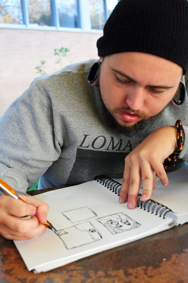 Alex Johnson, 23, Art major with emphasis in Illustration, is hopeful about the prospective job opportunities available to him in his field. Photo Credit: Karlee Johnson / Daily Sundial