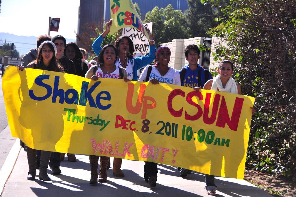 CSUN Shout Out Scholars lead a walk out march through campus, raising awareness of school issues. Protesters yelled,