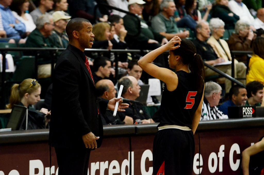 CSUN+head+coach+Jason+Flowers+talks+to+guard+Ashlee+Guay+about+a+foul+she+commited+during+their+game+against+Cal+Poly.+Fouls+were+one+of+many+areas+where+CSUN+struggled+in+its+loss+to+the+Mustangs+Saturday+night.+Photo+Credit%3A+Ken+Scarboro+%2F+Editor+in+chief