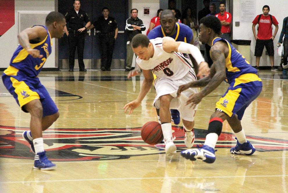CSUN guard Josh Greene, middle, loses the ball moments before the final buzzer of his team's 63-61 loss to UC Riverside Wednesday night. The match was the last home game of the season for the Matadors. Photo Credit: Tessie Navarro / Multimedia Editor