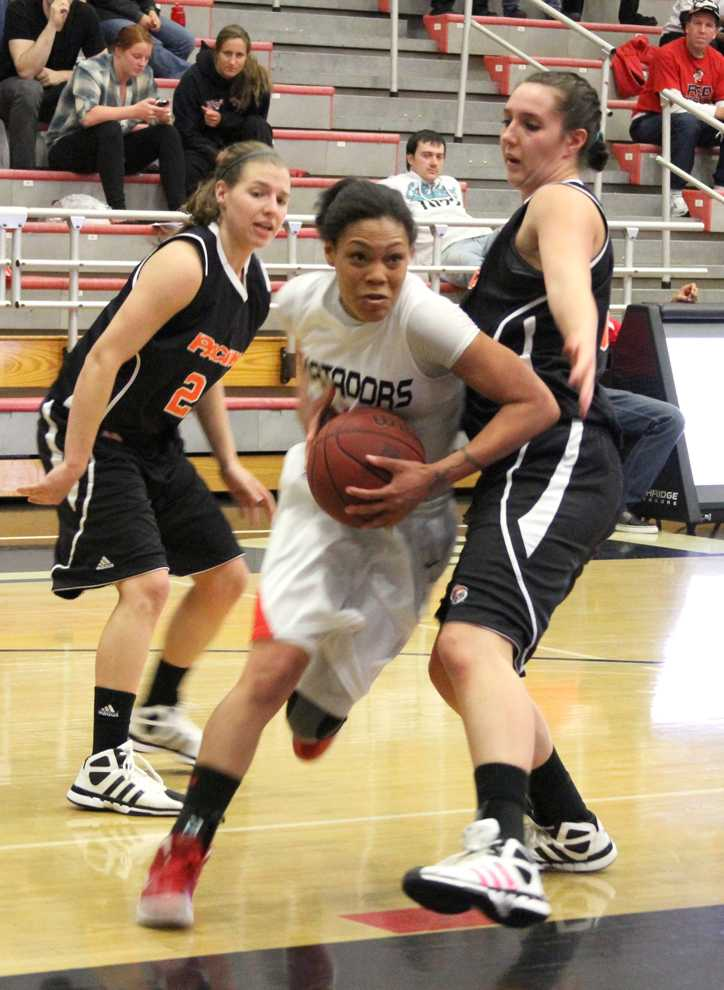 Matador guard Janae Sharpe drives into the paint looking for a layup in their game against Pacific Thursday night. Sharpe led her team to a