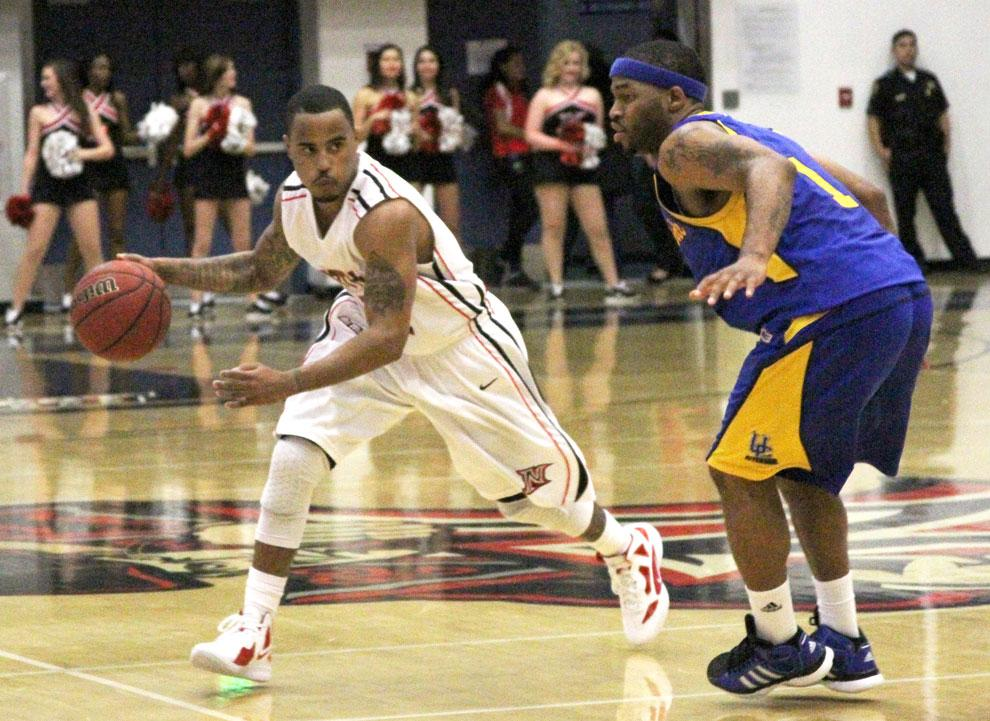 Guard Vinnie McGhee dribbles around a UCR defender last Wednesday. McGhee will play in his final game as a Matador tonight at Fullerton. Photo Credit: Tessie Navarro / Multimedia Editor
