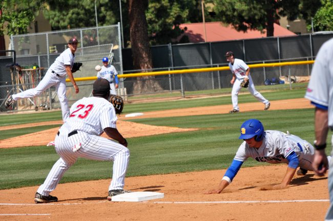 Pitcher Vincent Roberts throws a UCSB player out at first base last season. CSUN hosts UCLA in its season opener today. Sundial File Photo